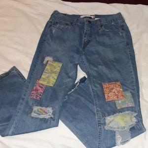 Vintage Levi's 515 Patched Jeans 10M